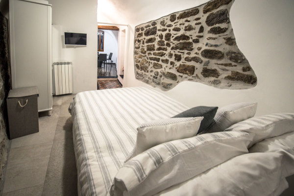 Bedroom with fine bed line Italian Riviera